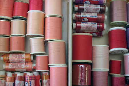 Pink and Red Spools of Thread